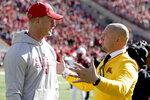 Nebraska head coach Scott Frost, left, and Minnesota head coach P. J. Fleck chat before an NCAA college football game in Lincoln, Neb., Saturday, Oct. 20, 2018. (AP Photo/Nati Harnik)
