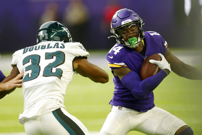 Minnesota Vikings wide receiver Stefon Diggs (14) runs from Philadelphia Eagles cornerback Rasul Douglas (32) during the first half of an NFL football game, Sunday, Oct. 13, 2019, in Minneapolis. (AP Photo/Jim Mone)