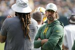 Green Bay Packers' Aaron Rodgers watches from the sidelines during the first half of a preseason NFL football game against the New York Jets Saturday, Aug. 21, 2021, in Green Bay, Wis. (AP Photo/Mike Roemer)