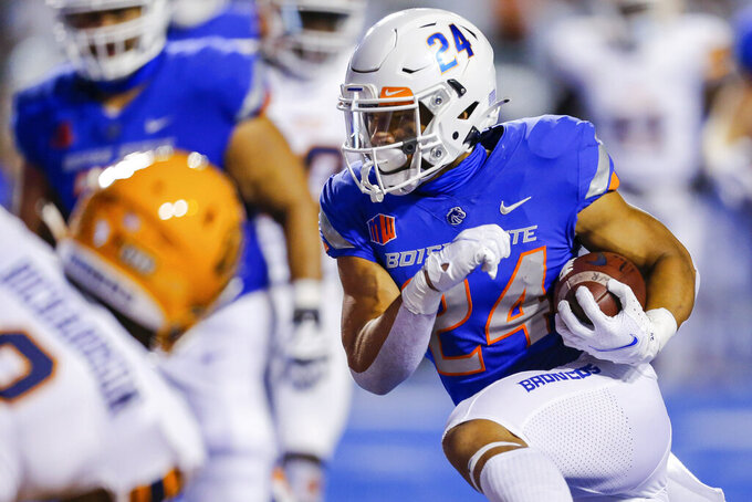 Boise State running back George Holani (24) cuts back against the UTEP defense for a 10-yard touchdown during the first half of an NCAA college football game Friday, Sept. 10, 2021, in Boise, Idaho. (AP Photo/Steve Conner)