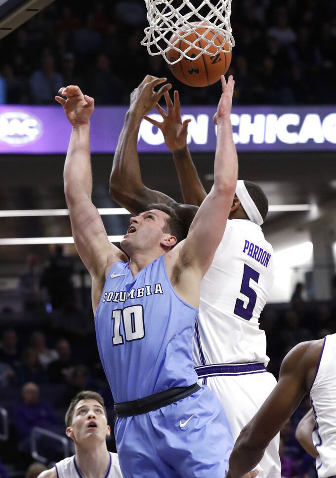 Columbia guard Quinton Adlesh, front left, and Northwestern center Dererk Pardon battle for a rebound during the first half of an NCAA college basketball game Sunday, Dec. 30, 2018, in Evanston, Ill. (AP Photo/Nam Y. Huh)