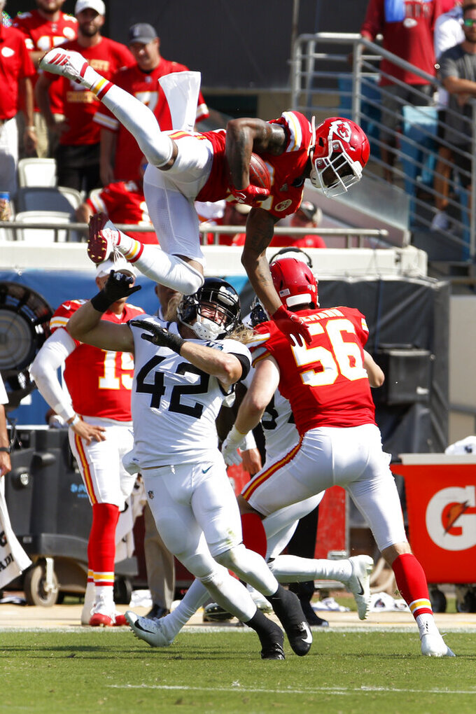 Kansas City Chiefs' Armani Watts, top, leaps high over Jacksonville Jaguars' Andrew Wingard (42) to grab an onside kick during the second half of an NFL football game, Sunday, Sept. 8, 2019, in Jacksonville, Fla. (AP Photo/Stephen B. Morton)
