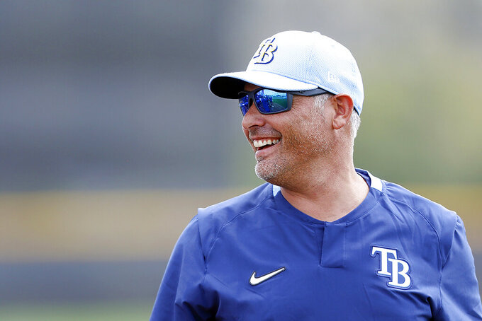 FILE  - In this Feb. 13, 2020, file photo, Tampa Bay Rays manager Kevin Cash takes the practice field during the start of baseball spring training in Port Charlotte, Fla. Cash was named AL manager of the year Tuesday night, Nov. 10, 2020. (Octavio Jones/Tampa Bay Times via AP, File)