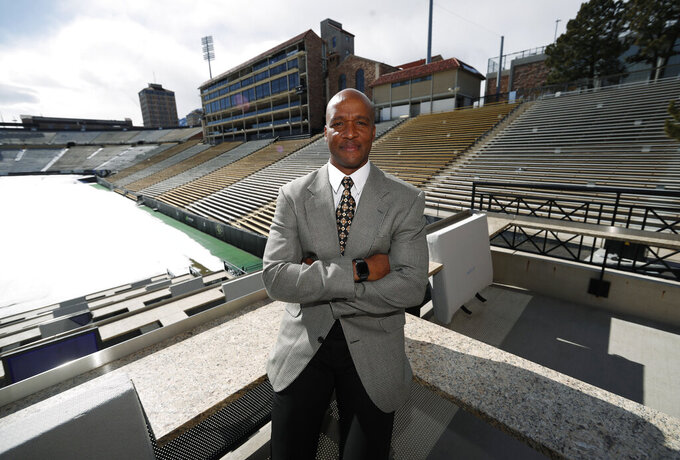 Karl Dorrell poses for a photograph overlooking Folsom Field after a news conference to announce that he is the new NCAA college head football coach at Colorado during a news conference Monday, Feb. 24, 2020, in Boulder, Colo. (AP Photo/David Zalubowski)