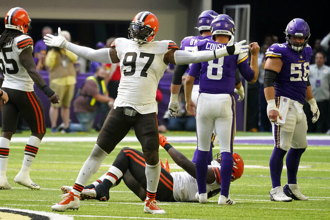 Cleveland Browns defensive tackle Malik Jackson (97) celebrates after making a tackle during the second half of an NFL football game against the Minnesota Vikings, Sunday, Oct. 3, 2021, in Minneapolis. The Browns won 14-7. (AP Photo/Jim Mone)