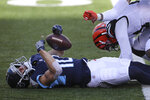 Tennessee Titans' Adam Humphries (10) is tackled by Cincinnati Bengals' Mackensie Alexander (21) during the first half of an NFL football game, Sunday, Nov. 1, 2020, in Cincinnati. Humphries was injured on the play and carted off the field. (AP Photo/Jay LaPrete)
