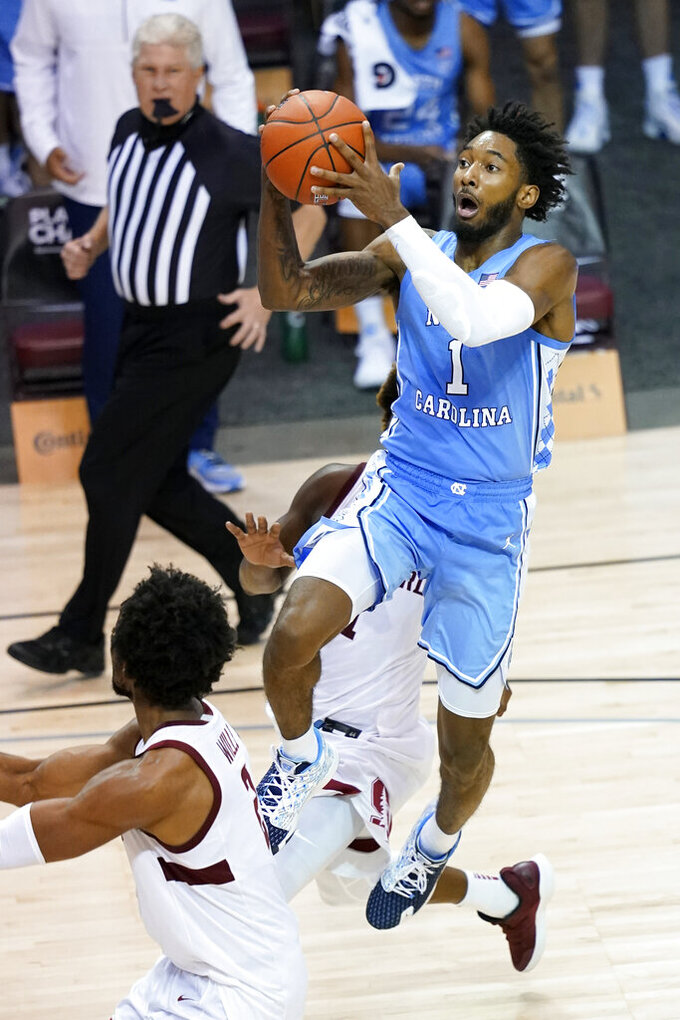 North Carolina guard Leaky Black (1) drives to the basket against Stanford in the second half of an NCAA college basketball game in the semifinals of the Maui Invitational, Tuesday, Dec. 1, 2020, in Asheville, N.C. (AP Photo/Kathy Kmonicek)