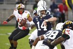 Penn State quarterback Sean Clifford (14) looks to throw a second-quarter pass against Maryland during an NCAA college football game in State College, Pa., Saturday, Nov. 7, 2020. (AP Photo/Barry Reeger)