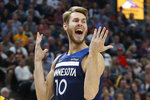 Minnesota Timberwolves forward Jake Layman (10) reacts after a foul in the first half during an NBA basketball game against the Utah Jazz, Monday, Nov. 18, 2019, in Salt Lake City. (AP Photo/Rick Bowmer)