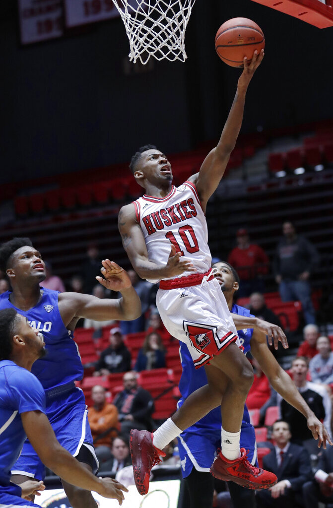 Northern Illinois guard Eugene German (10) drives to the basket against Buffalo during the second half of an NCAA college basketball game Tuesday, Jan. 22, 2019, in DeKalb, Ill. Northern Illinois won 77-75. (AP Photo/Nam Y. Huh)