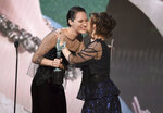 Phoebe Waller-Bridge, left, presents the award for outstanding performance by an ensemble in a drama series to Helena Bonham Carter at the 26th annual Screen Actors Guild Awards at the Shrine Auditorium & Expo Hall on Sunday, Jan. 19, 2020, in Los Angeles. (Photo/Chris Pizzello)