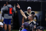 New Orleans Saints quarterback Drew Brees reacts after defeating the Los Angeles Chargers in overtime of an NFL football game in New Orleans, Monday, Oct. 12, 2020. The Saints won 30-27. (AP Photo/Butch Dill)