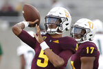 Arizona State quarterback Jayden Daniels (5) warms up for the team's NCAA college football game against Sacramento State, Friday, Sept. 6, 2019, in Tempe, Ariz. (AP Photo/Matt York)