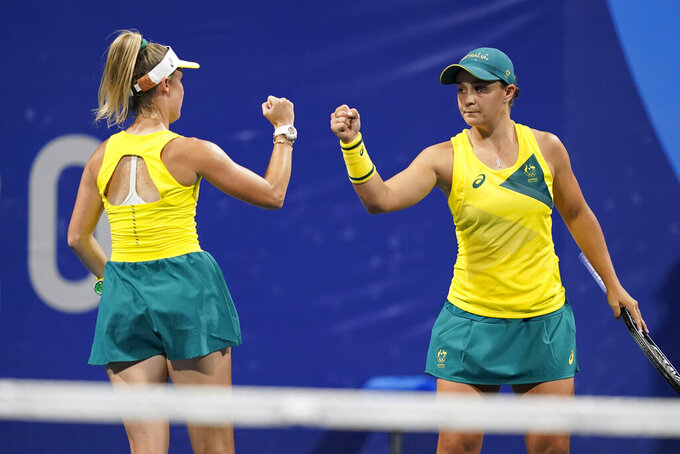 Storm Sanders, left, and Ashleigh Barty, of Australia, react during a women's doubles tennis match against Xu Yifan and Yang Zhaoxuan, of China, at the 2020 Summer Olympics, Monday, July 26, 2021, in Tokyo, Japan. (AP Photo/Patrick Semansky)