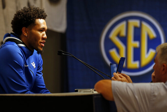 Kentucky's EJ Montgomery speaks during the Southeastern Conference NCAA college basketball media day, Wednesday, Oct. 16, 2019, in Birmingham, Ala. (AP Photo/Butch Dill)