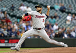 Minnesota Twins starting pitcher Martin Perez throws to a Seattle Mariners batter during the first inning of a baseball game Friday, May 17, 2019, in Seattle. (AP Photo/Elaine Thompson)