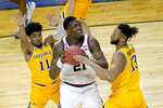 Illinois center Kofi Cockburn (21) looks at the basket as Drexel's Camren Wynter (11) and Tim Perry Jr. defend during the first half of a first round NCAA college basketball tournament game Friday, March 19, 2021, at the Indiana Farmers Coliseum in Indianapolis .(AP Photo/Charles Rex Arbogast)