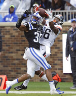 Duke safety Brandon Feamster (30) and Virginia wide receiver Ugo Obasi (86) reach for a pass during the first half of an NCAA college football game in Durham, N.C., Saturday, Oct. 20, 2018. The pass fell incomplete. (AP Photo/Gerry Broome)