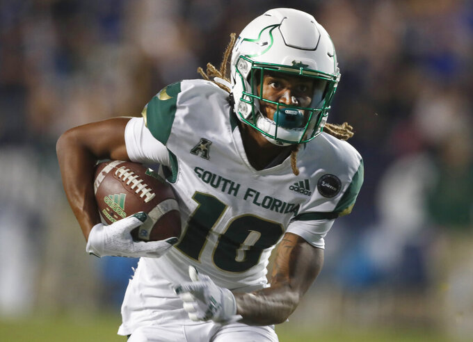 South Florida wide receiver Xavier Weaver (10) runs for a touchdown in the second half of an NCAA college football game against BYU Saturday, Sept. 25, 2021, in Provo, Utah. (AP Photo/George Frey)