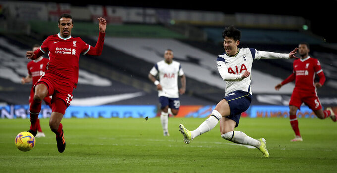 Tottenham's Son Heung-min, right, shoots on goal during the English Premier League soccer match between Tottenham Hotspur and Liverpool at the Tottenham Hotspur Stadium in London, Thursday, Jan. 28, 2021. (Nick Potts/Pool via AP)