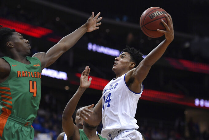 Seton Hall guard Jared Rhoden (14) attempts a basket as Florida A&M guard Rod Melton Jr. (4) defends during the second half of an NCAA college basketball game, Saturday, Nov. 23, 2019 in Newark, N.J. (AP Photo/Sarah Stier)