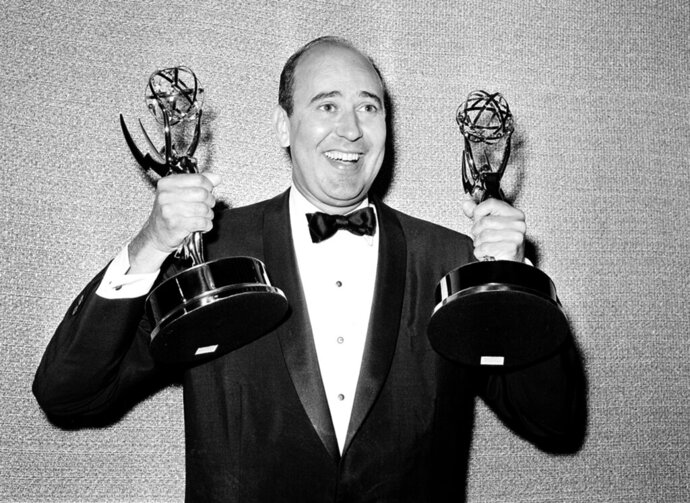 FILE - In this May 26, 1963 file photo, Carl Reiner shows holds two Emmy statuettes presented to him as best comedy writer for the