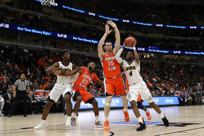 Iowa's Isaiah Moss (4) drives against Illinois's Giorgi Bezhanishvili (15) during the second half of an NCAA college basketball game in the second round of the Big Ten Conference tournament, Thursday, March 14, 2019, in Chicago. (AP Photo/Nam Y. Huh)