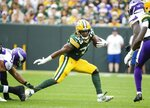 Green Bay Packers' Aaron Jones runs during the first half of an NFL football game against the Minnesota Vikings Sunday, Sept. 15, 2019, in Green Bay, Wis. (AP Photo/Mike Roemer)