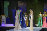 Ana Marcelo, an agroindustrial engineer from the city of Esteli, center right, reacts after being chosen Miss Nicaragua, in Managua, Nicaragua, Saturday, Aug. 8, 2020. Marcelo was crowned in front of a limited audience (two people per contestant spaced safely) plus a production crew of 85. The masks were off the contestants, but the judges wore them and were spaced at a safe distance. (AP Photo/Alfredo Zuniga)