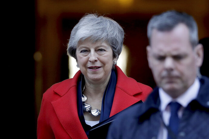 Britain's Prime Minister Theresa May leaves 10 Downing Street to make a statement to the Houses of Parliament in London, Tuesday, Feb. 26, 2019. (AP Photo/Matt Dunham)