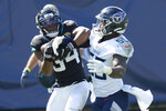 Jacksonville Jaguars running back Chris Thompson (34) catches a touchdown pass as he is defended by Tennessee Titans inside linebacker Jayon Brown (55) in the second half of an NFL football game Sunday, Sept. 20, 2020, in Nashville, Tenn. (AP Photo/Mark Zaleski)
