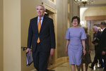 Sen. Rob Portman, R-Ohio, left, and Sen. Susan Collins, R-Maine, smile as they emerge from the office of Senate Republican Leader Mitch McConnell to announce agreement with Democrats on a $1 trillion infrastructure bill and are ready to vote to take up the bill, at the Capitol in Washington, Wednesday, July 28, 2021. (AP Photo/J. Scott Applewhite)