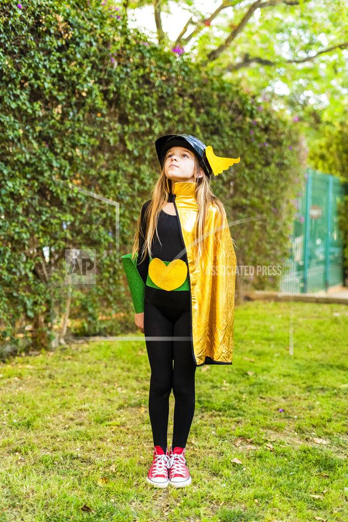 Girl posing in super heroine costume