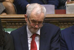 In this grab taken from video, Labour leader Jeremy Corbyn listens to the conclusion of the debate ahead of a vote on the Britan's Prime Minister, Theresa May's Brexit deal, in the House of Commons, London, Tuesday Jan. 15, 2019. British lawmakers have begun voting on whether to approve or reject the divorce agreement between the government and the European Union. (House of Commons/PA via AP)