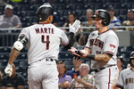Arizona Diamondbacks' Ketel Marte, left is greeted by Asdrubal Cabrera after hitting a two-run home run against the Pittsburgh Pirates during the eighth inning of a baseball game Tuesday, Aug. 24, 2021, in Pittsburgh. (AP Photo/Keith Srakocic)