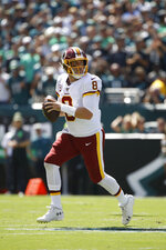 Washington Redskins' Case Keenum looks to pass during the first half of an NFL football game against the Philadelphia Eagles, Sunday, Sept. 8, 2019, in Philadelphia. (AP Photo/Matt Rourke)