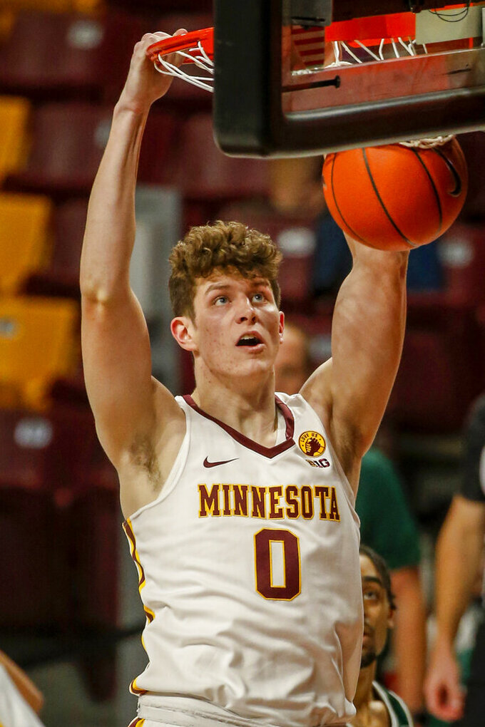 Minnesota center Liam Robbins dunks against Green Bay during the first half of an NCAA college basketball game Wednesday, Nov. 25, 2020, in Minneapolis. (AP Photo/Bruce Kluckhohn)