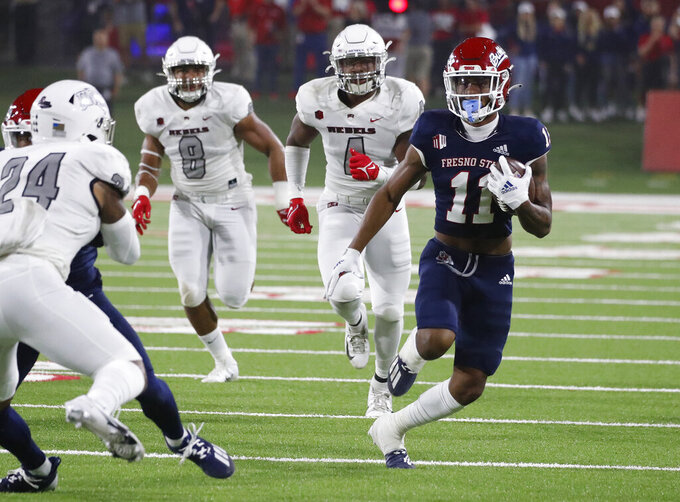 Fresno State wide receiver Josh Kelly runs around UNLV defenders during the first half of an NCAA college football game in Fresno, Calif., Friday, Sept. 24, 2021. (AP Photo/Gary Kazanjian)