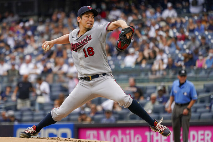 Minnesota Twins pitcher Kenta Maeda delivers against the New York Yankees in the first inning of a baseball game, Saturday, Aug. 21, 2021, in New York. (AP Photo/Mary Altaffer)