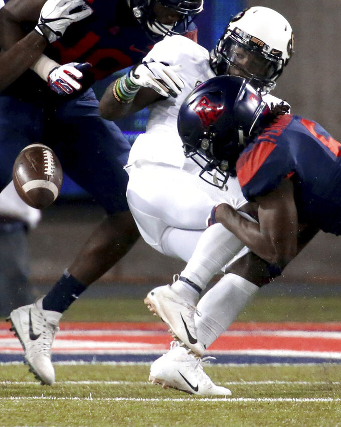 Arizona safety Demetrius Flannigan-Fowles (6) knocks the ball out of the hands of Colorado wide receiver K.D. Nixon, stopping him on fourth and short during the first quarter of an NCAA college football game Friday, Nov. 2, 2018, in Tucson, Ariz. (Kelly Presnell/Arizona Daily Star via AP)