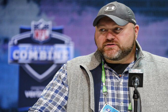 FILE - In this Feb. 25, 2020, file photo, New York Jets general manager Joe Douglas speaks during a press conference at the NFL football scouting combine in Indianapolis. Douglas and the Jets were busy in free agency, filling some of the many holes that marked the team's talent-needy roster. There are still plenty more to plug. With the No. 11 overall pick in the NFL draft, the Jets will have the opportunity to add an impact player early. (AP Photo/Michael Conroy, File)