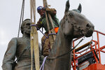 Work crews remove the statue of confederate general Stonewall Jackson, Wednesday, July 1, 2020, in Richmond, Va. Richmond Mayor Levar Stoney has ordered the immediate removal of all Confederate statues in the city, saying he was using his emergency powers to speed up the healing process for the former capital of the Confederacy amid weeks of protests over police brutality and racial injustice. (AP Photo/Steve Helber)