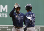 Tampa Bay Rays' Yandy Diaz, left, celebrates with Rays' Daniel Robertson, right, after Robertson hit a two-run home run allowing Diaz to score in the first inning of a baseball game against the Boston Red Sox, at Fenway Park, Sunday, April 28, 2019, in Boston. (AP Photo/Steven Senne)