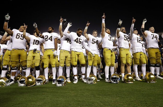 Notre Dame players celebrate after defeating Navy 44-22 in an NCAA college football game, Saturday, Oct. 27, 2018, in San Diego. (AP Photo/Gregory Bull)