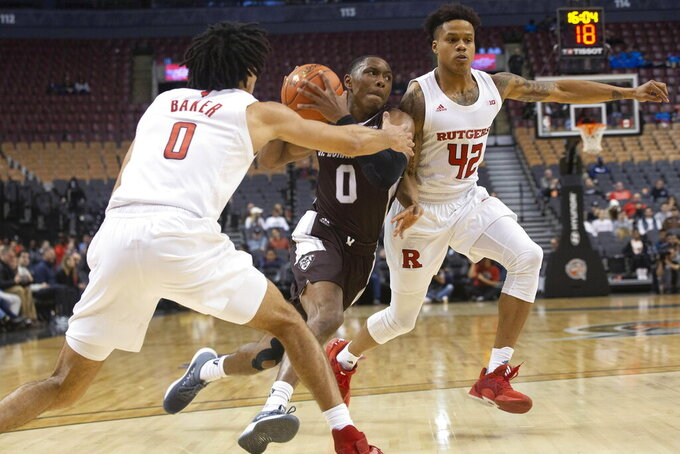 St. Bonaventure' Kyle Lofton drives between Rutgers' Geo Baker, left, and Jacob Young during the second half of an NCAA college basketball game in the James Naismith Classic in Toronto on Saturday, Nov. 16, 2019. (Chris Young/The Canadian Press via AP)
