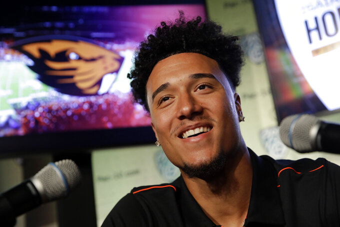 FILE - In this July 24, 2019, file photo, Oregon State wide receiver Isaiah Hodgins answer questions during the Pac-12 Conference NCAA college football Media Day, in Los Angeles. Hodgins was selected to The Associated Press All-Pac 12 Conference team, Thursday, Dec. 12, 2019. (AP Photo/Marcio Jose Sanchez, File)