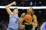 Marquette's Greg Elliott drives to the basket against Villanova's Collin Gillespie (2) during the first half of an NCAA college basketball game Saturday, Jan. 4, 2020, in Milwaukee. (AP Photo/Aaron Gash)