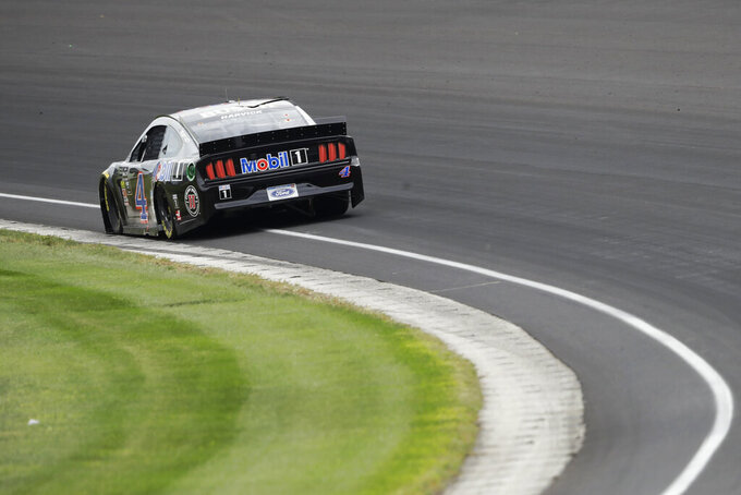 NASCAR Cup Series driver Kevin Harvick drives through Turn 1 during the NASCAR Brickyard 400 auto race at Indianapolis Motor Speedway, Sunday, Sept. 8, 2019, in Indianapolis. (AP Photo/Darron Cummings)