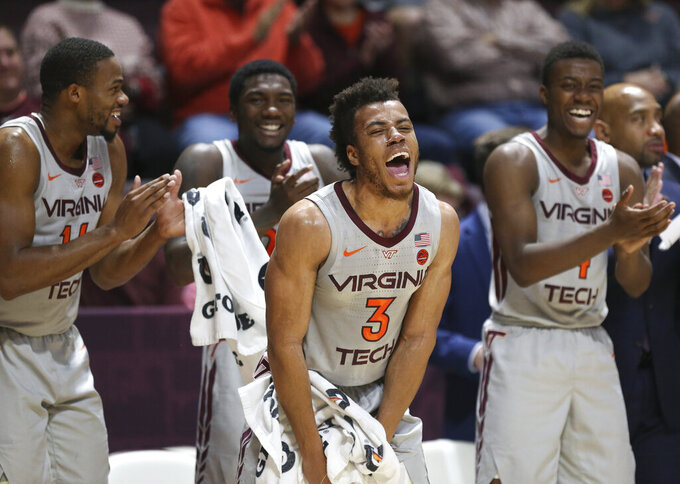 Wabissa Bede (3) and the Virginia Tech bench celebrate a defensive stop in the first half of of an NCAA college basketball game in Blacksburg Va. Wednesday, Nov. 20 2019. (Matt Gentry/The Roanoke Times via AP)