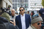Andrey Kukushkin leaves federal court, Thursday, Oct. 17, 2019, in New York. Kukushkin and David Correia pleaded not guilty Thursday to conspiring with associates of Rudy Giuliani to make illegal campaign contributions. They are among four men charged with using straw donors to make illegal contributions to politicians they thought could help their political and business interests.  (AP Photo/Kevin Hagen)